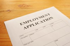 Employment application. Form on desk showing job search concept Stock Photography
