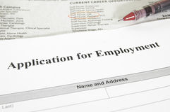 Employment application. Blank employment application and newspaper jobs section Stock Photography
