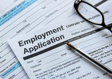 Employment application. Filling up employment application form Stock Images