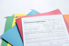 Employment Application Form. With colored folders in background Stock Photography