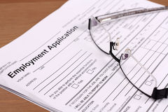 Employment Application Form. With glasses lying on Stock Photos