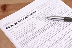 Employment Application Form. With pen on desk Stock Photo