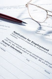 Employment application job. Close up of application for employment document Stock Image