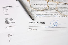 Employment contract. With pen and eyeglass - many uses for job related purpose Royalty Free Stock Images