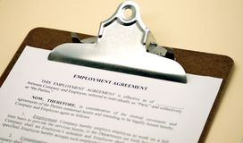 Employment Agreement on Clipboard Royalty Free Stock Photo
