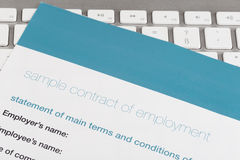 Employment contract. On the comuter keyboard Stock Photos