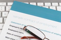 Employment contract. On the comuter keyboard Royalty Free Stock Photos