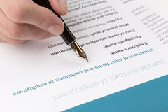 Employment contract. Female hand signs the employment contract Stock Photography