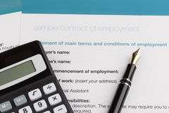 Employment contract. With fountain pen and calculator Royalty Free Stock Image