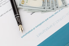 Employment contract. With fountain pen and dollars Stock Images