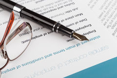Employment contract. With fountain pen and glasses Royalty Free Stock Photo