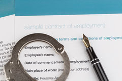 Employment contract. With fountain pen and handcuffs Royalty Free Stock Images