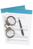 Employment contract. With fountain pen and handcuffs Royalty Free Stock Photography