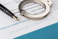 Employment contract. With fountain pen and handcuffs Stock Images