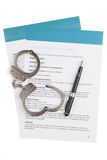 Employment contract. With fountain pen and handcuffs Royalty Free Stock Photo