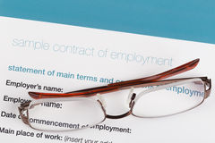 Employment contract. With a glasses Royalty Free Stock Photos