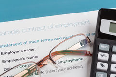 Employment contract with glasses Royalty Free Stock Photo