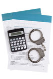 Employment contract. With handcuffs and calculator Stock Photos