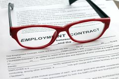 Employment contract. Image of blank and glasses. Employment contract. Photo of blank and red glasses Royalty Free Stock Photos