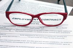 Employment contract. Shot of blank and red glasses. Employment contract. Image of blank and red glasses Stock Photography