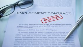 Employment contract rejected, officials hand stamping seal on business document