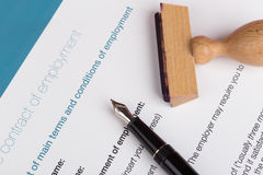 Employment contract with stamp Royalty Free Stock Photography