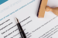 Employment contract with stamp stock photos