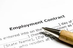 Employment contract with wooden pen stock image