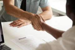 Employment handshake or making good first impression at intervie. Employment handshake or making good first impression at successful interview concept, african Royalty Free Stock Image
