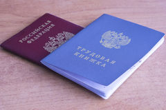 Employment history book and Russian Federation passport. History of the work book and a passport Russian Federation on the table Royalty Free Stock Image