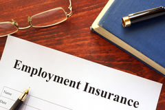 Employment Insurance form. Employment Insurance form on a wooden surface Stock Images
