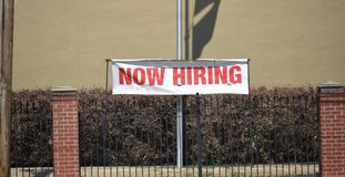 Employment Job Opportunity Now Hiring. A sign outside a business advertises that there are positions of employment opportunities available Stock Photos