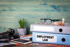 Employment law concept. Binders on desk in the office. Business background.  stock photo