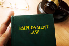 Employment law. Employment law on an office table Royalty Free Stock Photos