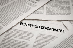 Employment opportunities headline. On newspaper background Stock Photos
