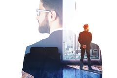 Employment and search concept. Thoughtful young european businessman standing in modern office interior with abstract city view and daylight. Double exposure Stock Photography