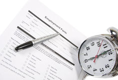 Employment Test. An employment test form with a pen and an alarm clock isolated on white Stock Image