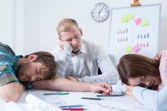 Employés après nuit au travail Image libre de droits