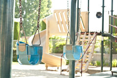 Emply Child Swings waiting for a Child Stock Image