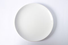 Emply plate. A white emply ceramic plate Royalty Free Stock Image