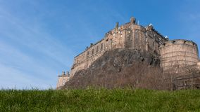An emposing castle on a hill royalty free stock photography
