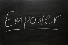 Empower. The word Empower written on a blackboard