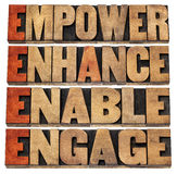 Empower, enhance, enable and engage in wood type Stock Photo