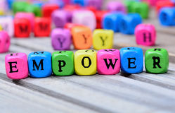 Empower word on table. Empower word on wooden table Royalty Free Stock Images