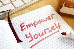 Empower yourself handwritten in a notepad. Royalty Free Stock Photo