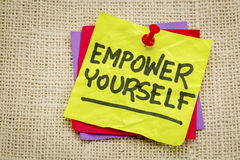 Empower yourself motivational reminder note. Empower yourself reminder - motivational text on a yellow sticky note stock photo