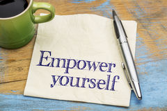 Empower yourself - napkin reminder note. Empower yourself  reminder or advice - handwriting on a napkin with a cup of coffee Royalty Free Stock Photography
