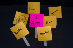 Empowering concept using I Am. Empowering self help message with the words I am in focus and all around it in and out of focus other positive thoughts and words Royalty Free Stock Photo