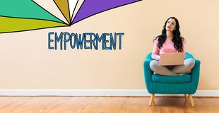 Empowerment with woman using a laptop. Empowerment with young woman using a laptop computer stock photo