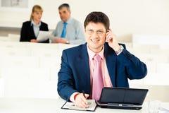 Empreendedor ocupado Foto de Stock Royalty Free